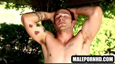 He is a hot musclular hunk with tattoos who is soloing